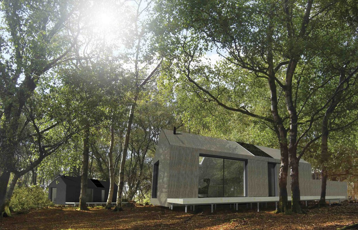 'Microhouse' of very simple container-style design, light brown coloured with large windows, with a shed in the rear and surrounded by tall trees in daylight.