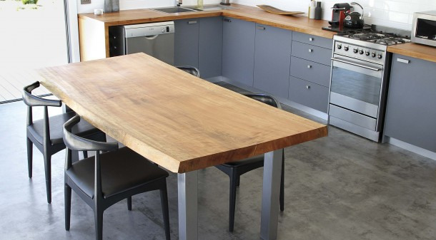 The kitchen benches and table were handcrafted by Sam from a single Tasmanian myrtle, milled and dried in north-west Tasmania close to where it was harvested from a friend's property.