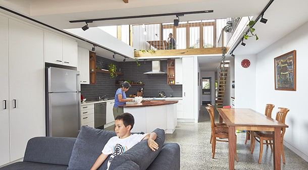 The central void allows for solar access deep into the living space, excellent ventilation pathways, and a sense of connection between occupants. Tim and Karen's dedication to sustainability saw them reuse their eight-year-old kitchen, with a few minor tweaks.