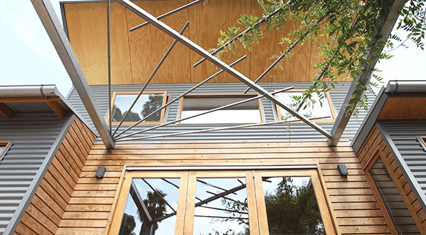 Deciduous vines will eventually grow across the pergola and provide shading during summer.