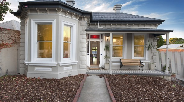 "When the owners bought it, the 120-year-old house was in a sad state of repair. They retained the four main rooms, reroofed, replaced the window sashes with double glazed ones, and redid the floorboards. ""The floors are mixed hardwoods supplied by Timber Revival, re-milled from trusses from the Melbourne Theatre Company's warehouse,"" they explain. ""They are not one specific species as these buildings were apparently made from whatever was available."""