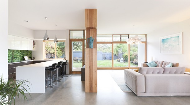 Built with SIP walls for insulation and a waffle pod concrete slab for thermal mass, the home's extension is very thermally efficient. The kitchen splashback is glass printed with an image of the climbing greenery on the wall outside, and the cooktop is induction as there is no gas to the house.
