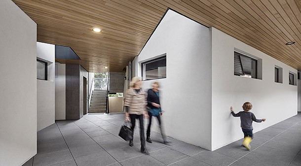 """Open breezeways and stairwells provide natural cross-ventilation to public access areas. Designer Luke Middleton describes them as """"elevated streets [that] allow the opportunity for neighbourly interactions""""."""