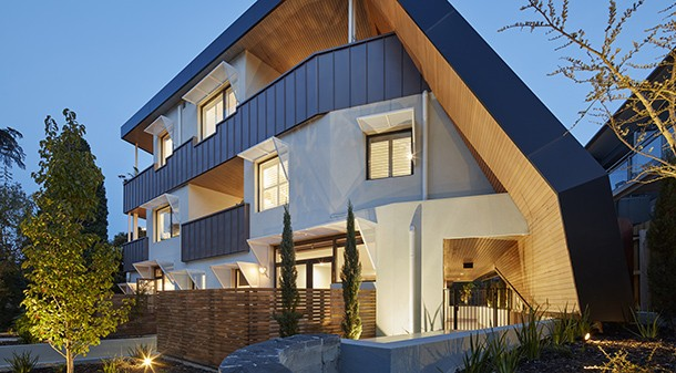 Artisan Apartments features high thermal mass reverse concrete block construction with rendered foam insulation. The sculpted design is based on passive solar principles, and the skewed plan ensures all 13 apartments have north-facing living areas and cross-flow ventilation.