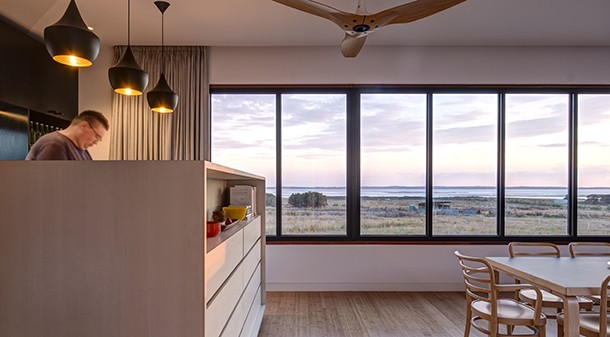 The south-facing double-glazed windows are fixed, and provide stunning views over the bay to Phillip Island. Split system air conditioners in the bedrooms are used for cooling in summer, while fans and selective use of cross breezes are sufficient for cooling the living space.