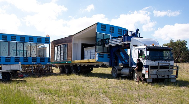 Unable to get a crane on-site, the modules were delivered by truck, backed up and clipped together. They arrived fully prefabricated with joinery, toilets and windows in place.
