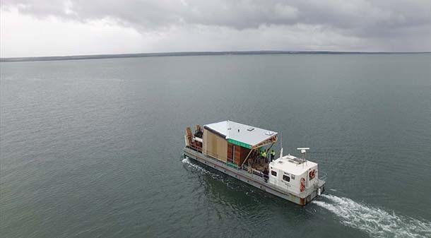 The prefabricated farmhouse was delivered as five modules, and over two days was transported by truck and barge to Helen and Ken's remote French Island farm. The entire build pivoted on the size and capacity of the barge.