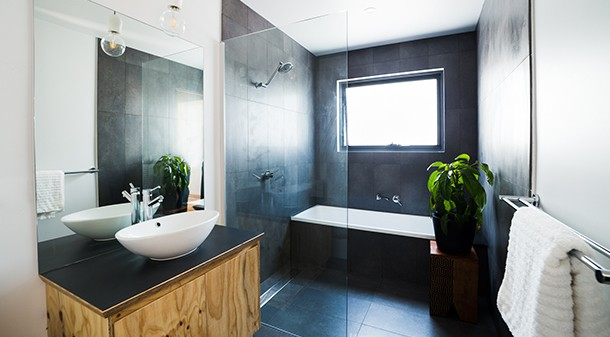 This three-bedroom home has one family-sized bathroom, with Ecoply joinery and WELS 4-star fittings used for water saving.