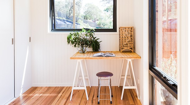 The study is located adjacent to the generous entry, and doubles as a laundry with ample storage (washing machine discreetly tucked behind cupboards).