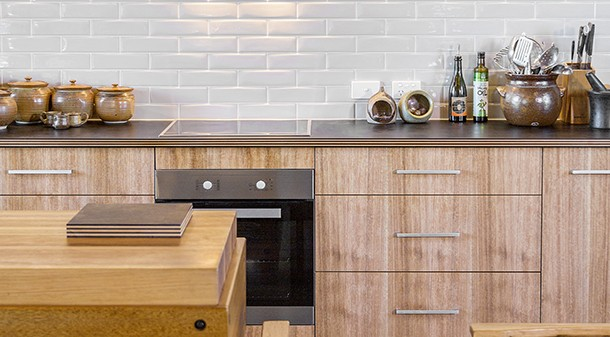 The benchtops are Paperock, an Australian product made from layers of recycled paper bonded with phenolic resin and compressed. Ian and Pam chose it for its sustainability credentials, and are delighted with the look and feel.
