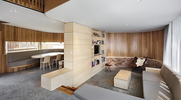 The front of the house is wide enough to accommodate a dining space and a sunken living room, with the front door in between. The double-height atrium in the centre of the downstairs space is a sunny play area for Victoria and Tim's son.