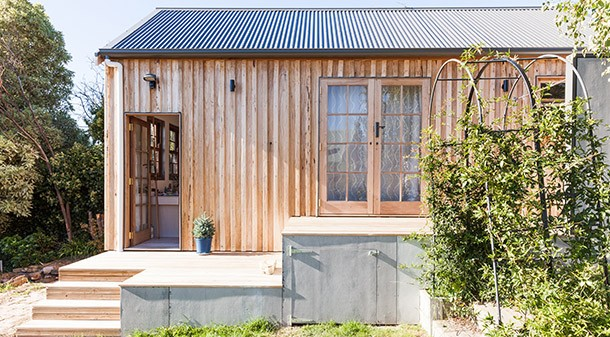 The modest floor area of the shack is complemented by a big deck and under-deck storage. For the cladding, raw fibre-cement sheet and radially sawn silvertop ash were chosen. The timber was left raw to minimise maintenance, and will weather to grey.