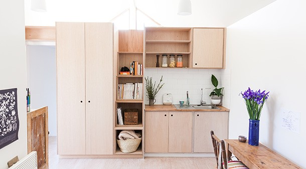 The kitchenette joinery is plywood sealed with a low-VOC Cutek finish. Look closely and you'll see a stairway to the loft cleverly integrated into the kitchen shelving.