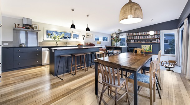 """""""It was hard to imagine living in a new house, but all our old furniture and artwork works well in it,"""" says Shelley. """"There's a lot of character from all the old, scratched materials."""" The ash floorboards were salvaged from a church hall; the dining table is a repurposed science lab bench."""