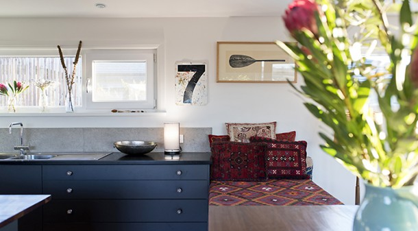 The black kitchen benchtops are Paperock,