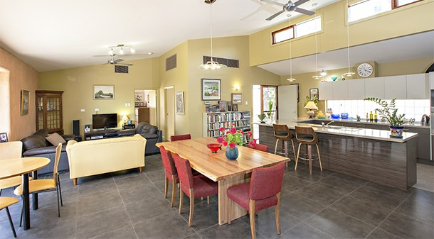 """The big central room is Margaret's favourite thing about the house. """"The room just works so well. It has a cosy little lounge space that invites people to talk. It has a stacking sliding door – we have a little breakfast table by it where the sun streams in."""""""