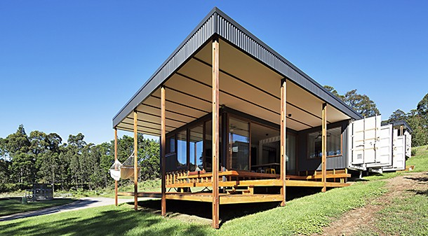 The container doors were left in place and act as moveable external shading for the bedroom windows when the family is using the house; when they're away, the doors are closed to help secure it and protect against possible bushfire.