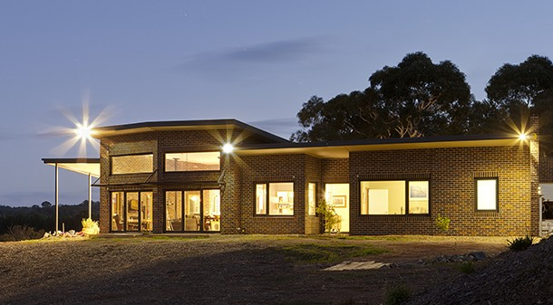Due to the bushfire risk of the site, brick, Colorbond and fire-resistant glass were chosen for the home's exterior. Ann and Ali saved some money by using seconds bricks.