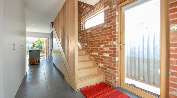 The eastern wall of the extension is of reverse recycled-brick veneer, providing thermal mass benefits and an attractive texture. And a second external door with ramp entry to the new part of the house means that no more prams will need to be left on the front porch.