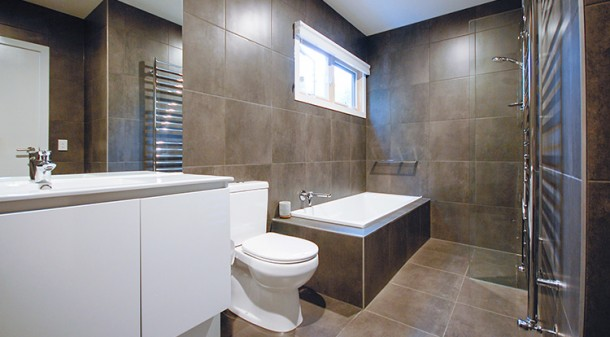 The layout of the bathroom with wet areas grouped together minimises the need for shower screens and streamlines cleaning; wide doorways and stepless thresholds makes the ground floor accessible to all.