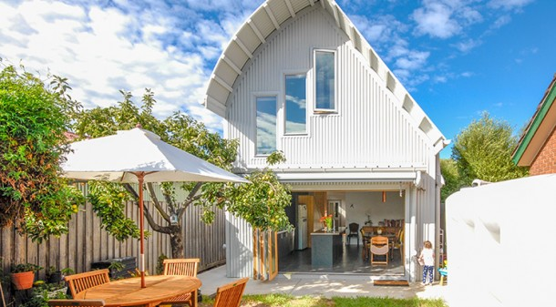 The renovation has added a storey, with two bedrooms and a bathroom tucked under a roofline designed to maximise internal space without impeding the solar access to their neighbours' courtyards.