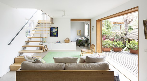 The stairwell serves multiple functions: it provides access to upstairs, additional daylighting into the living room and helps move warm air from downstairs to upstairs where, in summer, it can be vented outside.