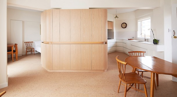 The centrepiece of this refurbished apartment is the custom joinery, which is not only elegant but performs three practical functions: it visually divides the space, provides ample storage and, due to the in-built handrail, makes the unit accessible for all potential residents.