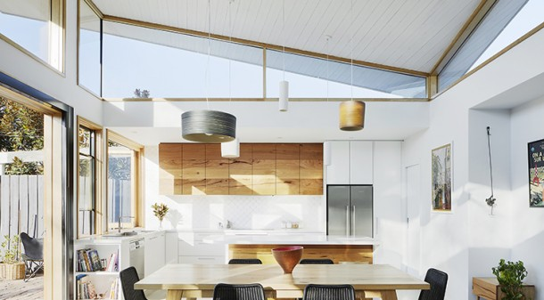 At first glance, the roofline of Glide House's extension is very similar to Curvy House's, reaching up to the north to admit an abundance of natural light. But instead of a curve, here the roof form comprises two planes that twist around the central ridgeline.