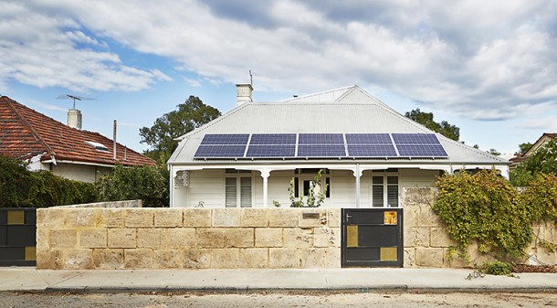 There is almost no hint of the rear addition from the front, but part of the 4.9kW solar system mounted on the verandah provides a clue to this home's environmental credentials.