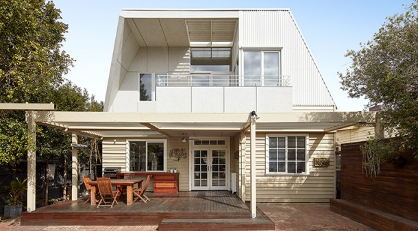 The back of the house faces north, so a variety of strategies was employed to ensure sunlight can be controlled. A pergola with adjustable Vergola louvre roofing covers the deck, while upstairs a carefully designed eave, fixed louvres and blinds provide shading when needed.