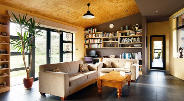 North-facing double-glazed windows – well shaded with eaves to block summer sun – are a feature of all three bedrooms and the open plan living area. The concrete slab floor is laid with porcelain tiles throughout the house.