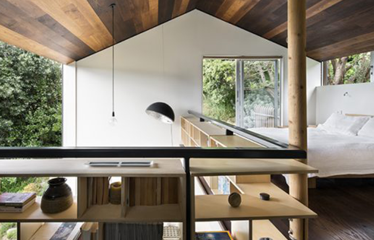 "Andrew set out to design a house that was ""small but not claustrophobic"". The bedroom looks across the void to the valley views and opens onto its own deck."