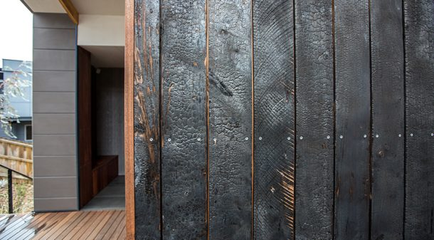 The 'Shou sugi-ban' burnt cypress shiplap cladding is made using local Macrocarpa, a species typically used as a windbreak on Tasmanian farms. The finish is low maintenance and strikingly beautiful.