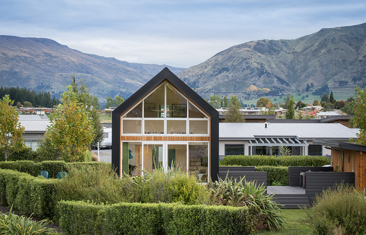 """Located on a corner block in a new housing estate in Wanaka, the house is small but has a big presence: """"I see people doing drive-bys trying to get a look in,"""" laughs neighbour and house designer Barry Condon."""
