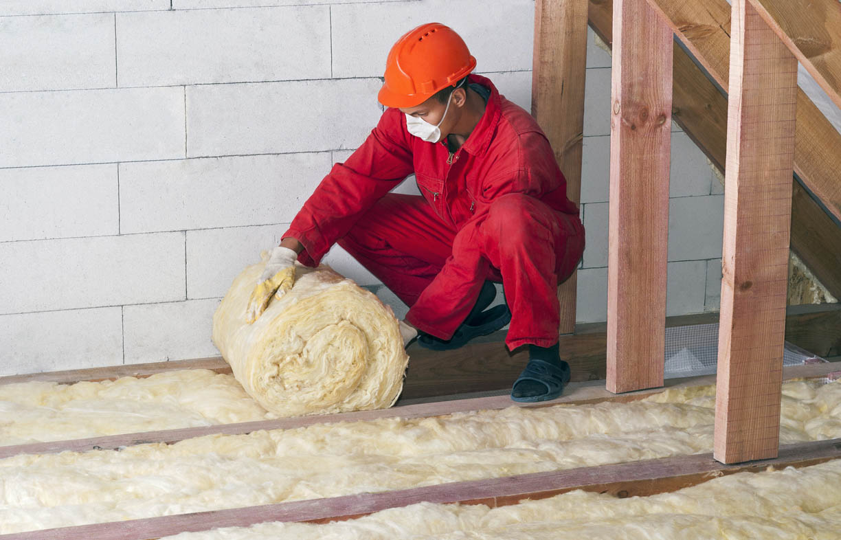 Glass wool materials come as both batts and blankets on a roll, shown here. Blankets make for faster installation where there are long sections with no crossing joists to fit around.