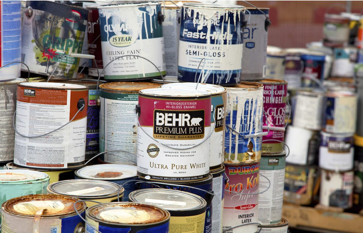 Fairfax, VA, USA - December 5, 2013: Paint cans gathered in order to be recycled. They will be sorted out and the latex ones will be separated from the oil cans. Unlike oil paints, latex paints aren't considered hazardous waste and can be recycled with metals. The oil cans will be brought to an household hazardous waste facility.