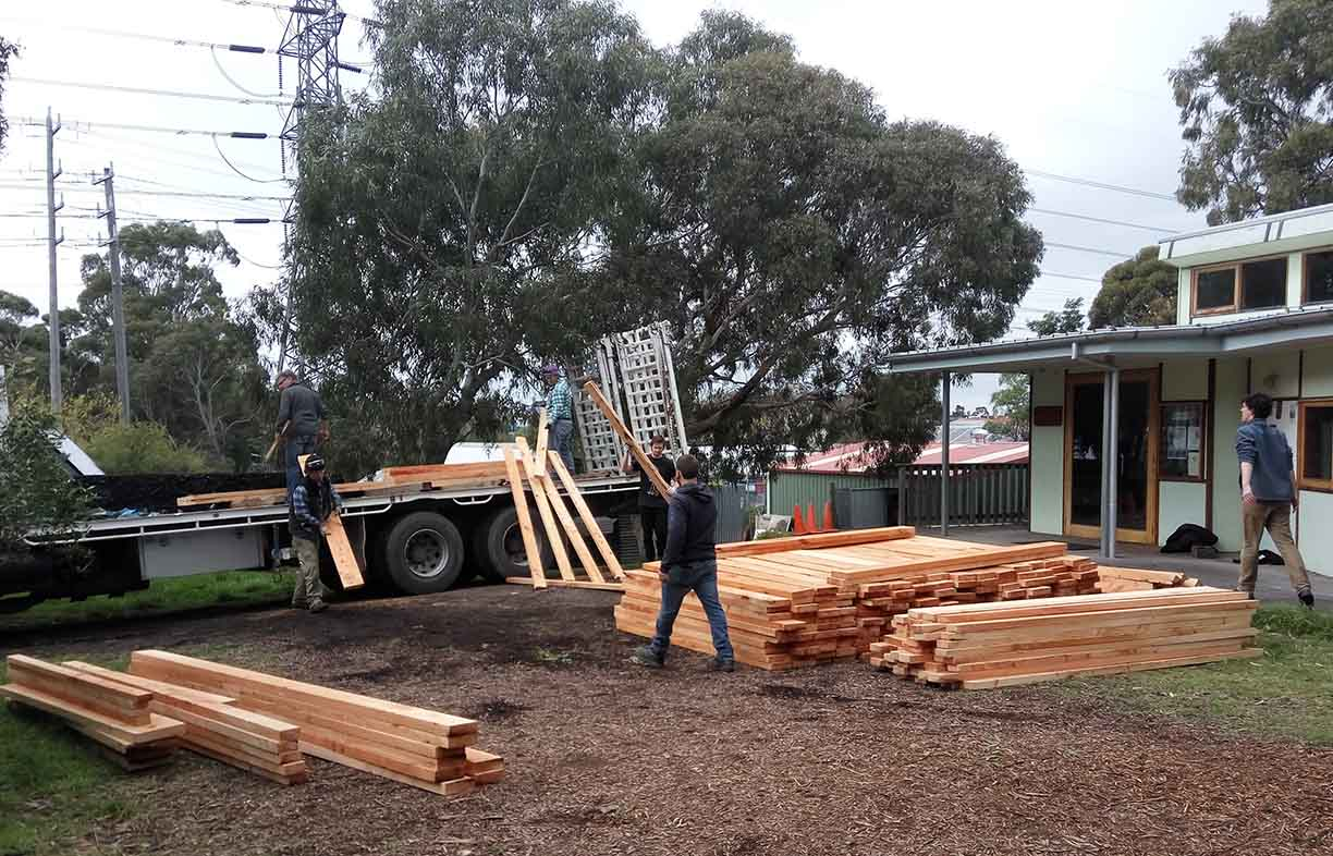 Moving salvaged Macrocarpa at Fair Wood's base at CERES in Brunswick, Victoria. Image: Jake Arzt