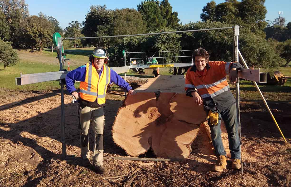 Paul Mackay (at right), an urban agroforester with a portable sawmill, is one of Fair Wood's suppliers. Paul cuts down trees around Melbourne that need to be removed and mills them on the spot.
