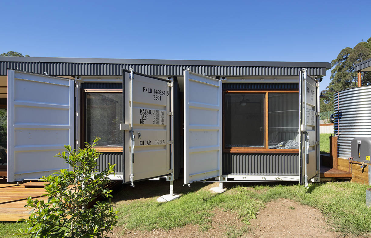 The South Coast Container House, opening again for Sustainable House Day this year, is rated BAL-29. Built with shipping containers, the container doors have been left on their hinges and can be closed to protect the glazing from bushfire, and angled to allow direct sunlight into the house in winter or to shade the windows in the heat of summer. Image: Simon Whitbread