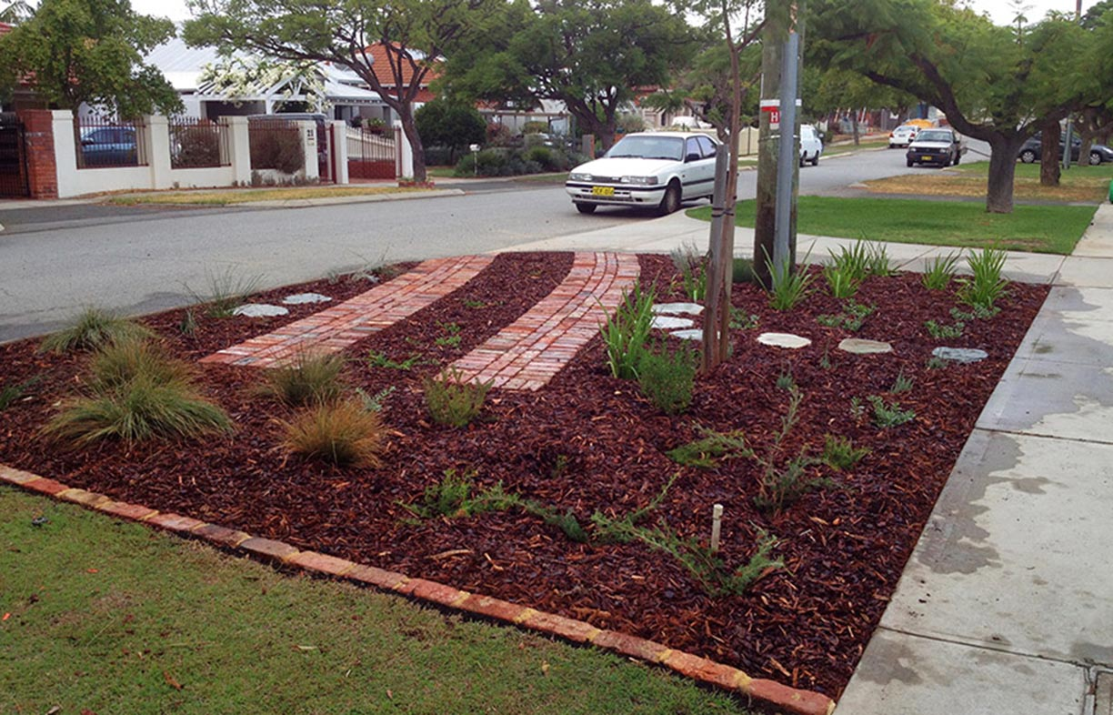 This multi-purpose verge, once fully grown, will eventually hide the parking space. Tip: Make sure you lower the soil level for verge gardens so mulch is contained behind the kerb.