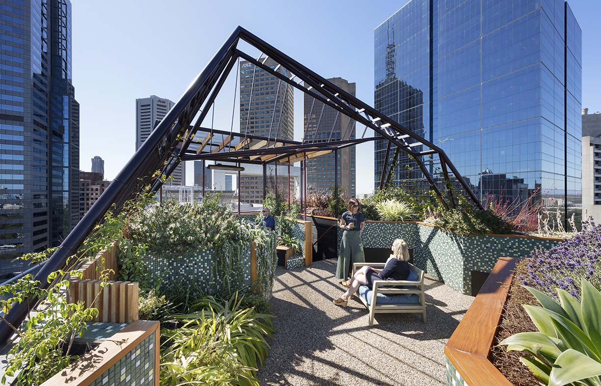 This rooftop garden uses patterns, including spider web-like shading structures and gardens, to connect residents with the order and chaos of the natural world. Image: Di Snape, taken at Bent Architecture's Phoenix project in Melbourne.