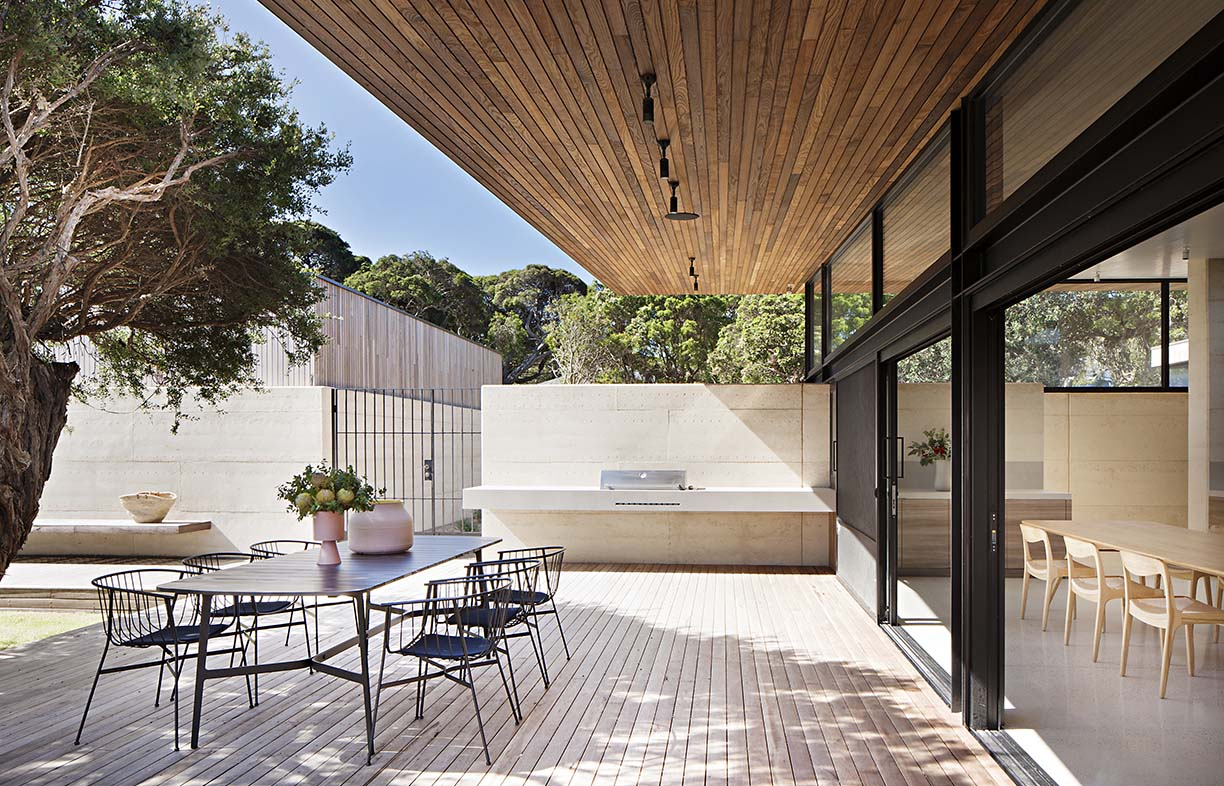 The Layer House by Robson Rak Architects is a great example of how natural materials, such as rammed earth, can be combined with shade plants to create a multi-seasonal living space. Image: Shannon McGrath