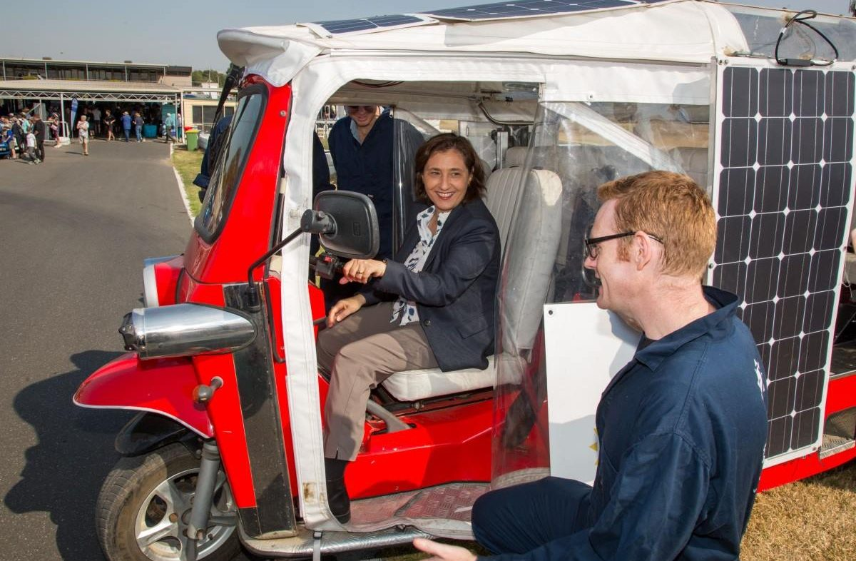Julian from Solar Tuk explaining the workings of the vehicle to The Hon. Lily D'Ambrosio MP.