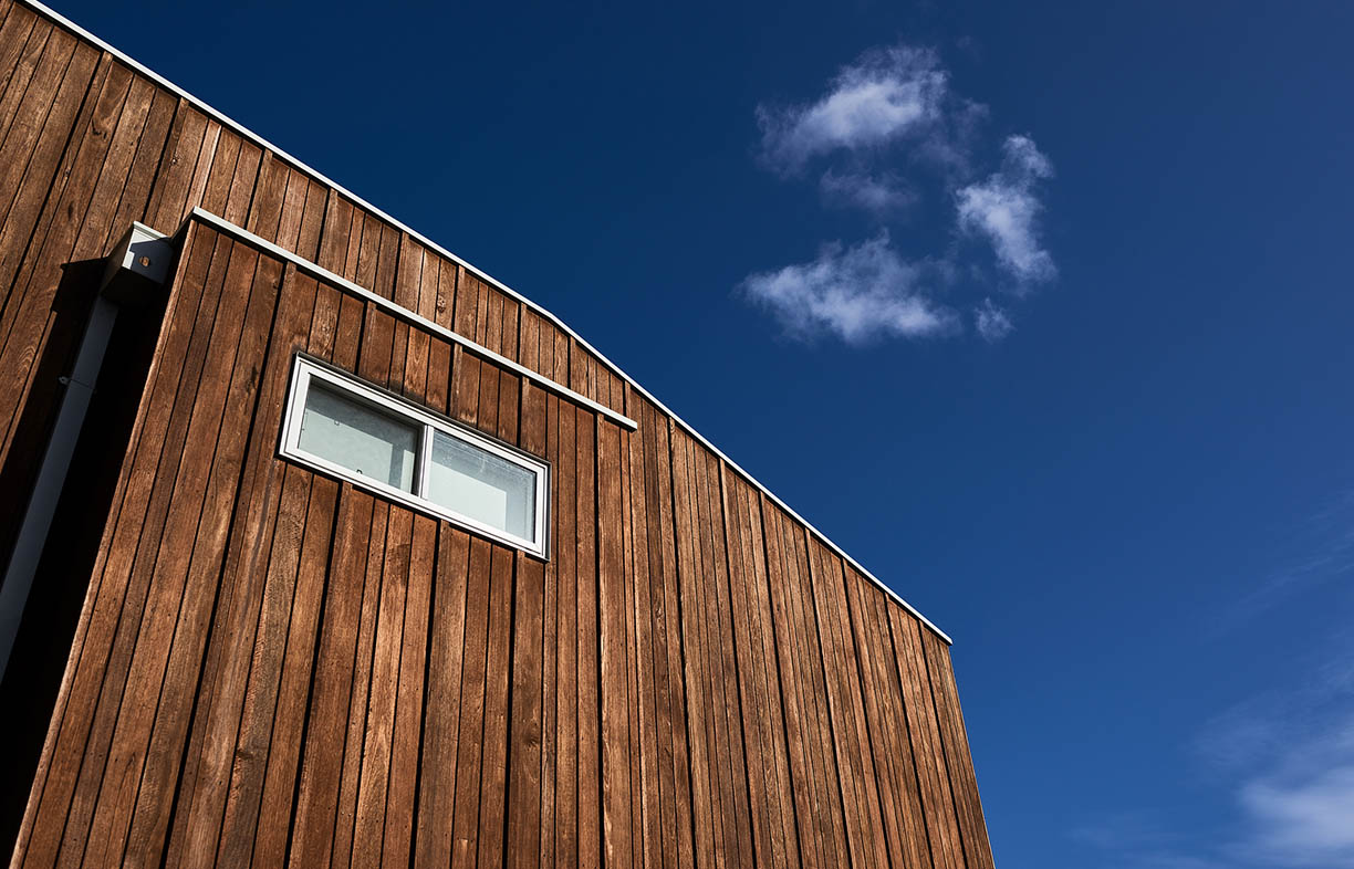 An example of modern Australian architecture in this wood cladded structure shot on a beautiful, warm sunny day.
