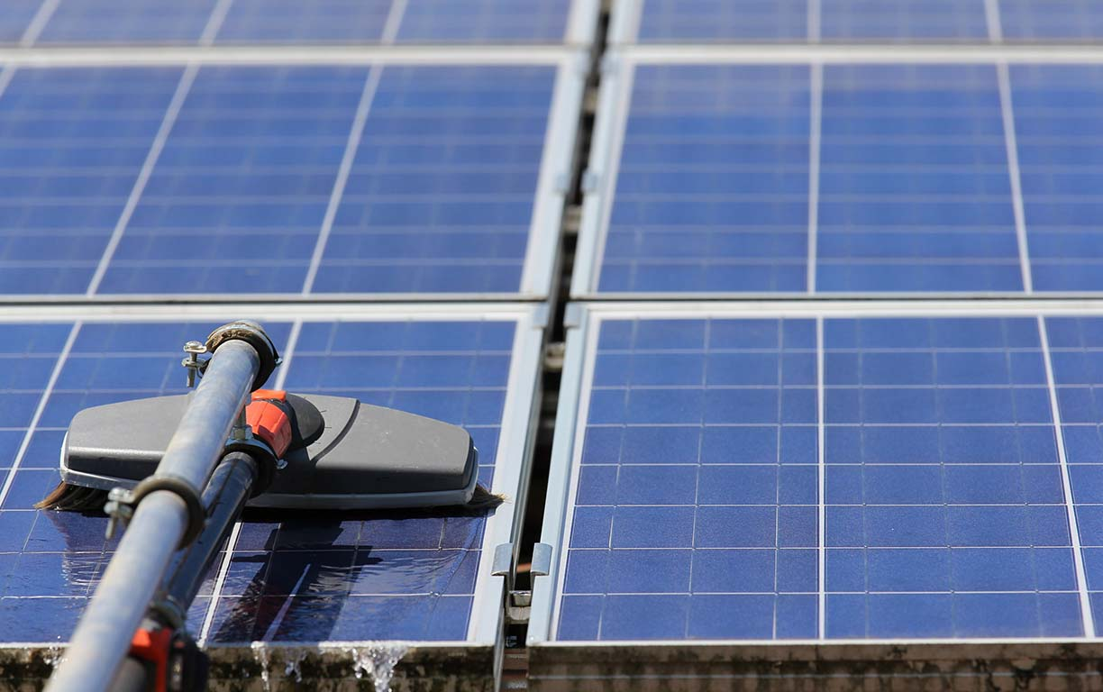 Cleaning the solar electricity from polls with a brush and water.